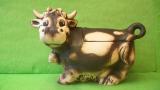 Dóza - vysmátá kráva